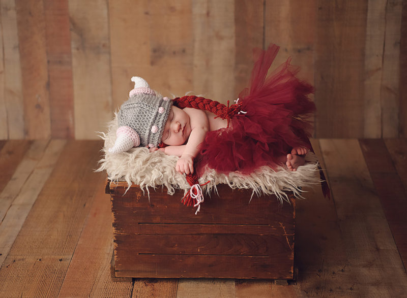 baby with viking hat and tutu