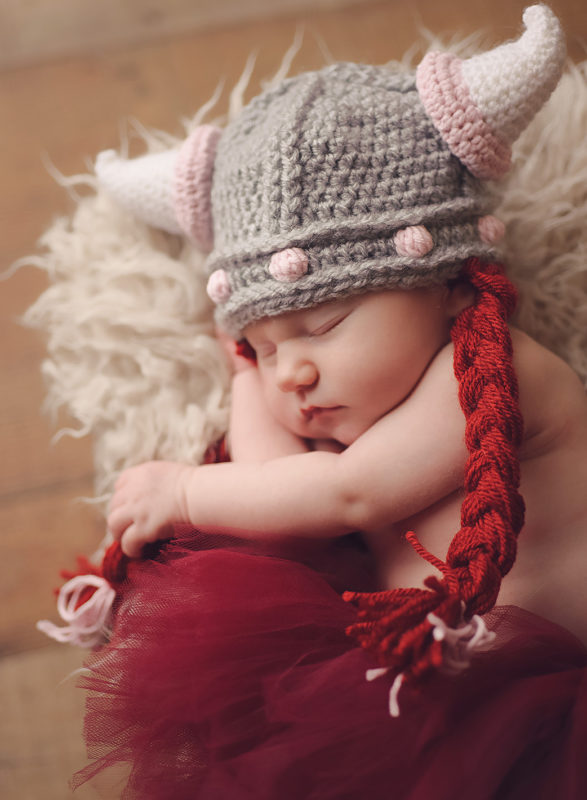 baby with knitted viking hat on