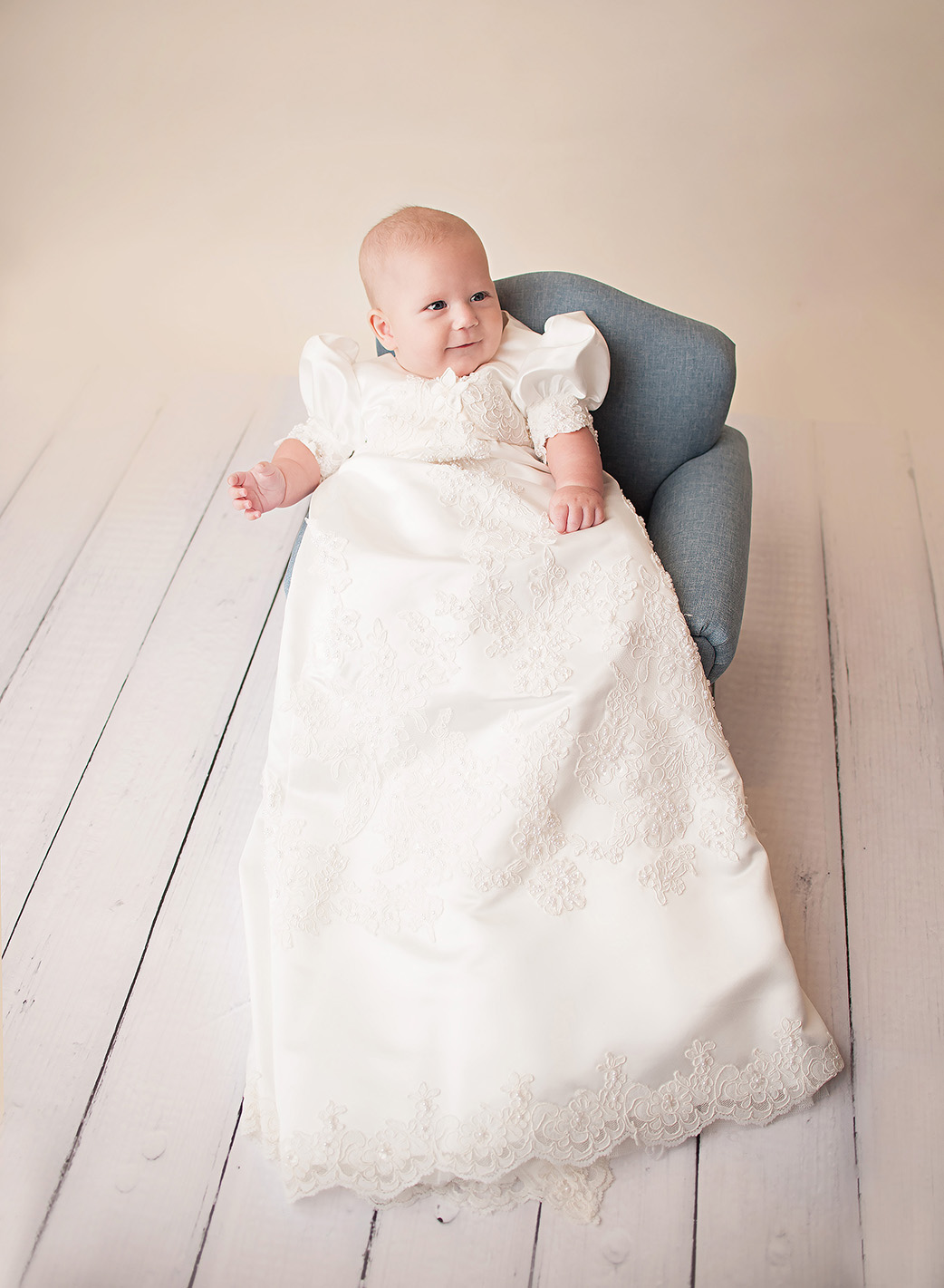 baby boy in baptism gown