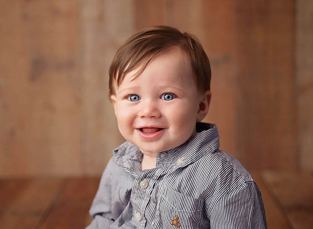 6 month old boy on in blue shirt