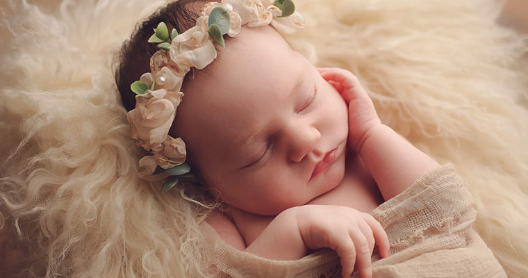 baby with cream floral crown