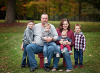 family photos bench outside with fall leavesn red b
