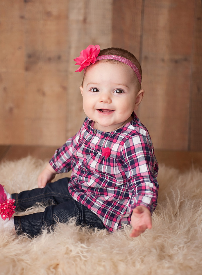 6 month old girl in plaid