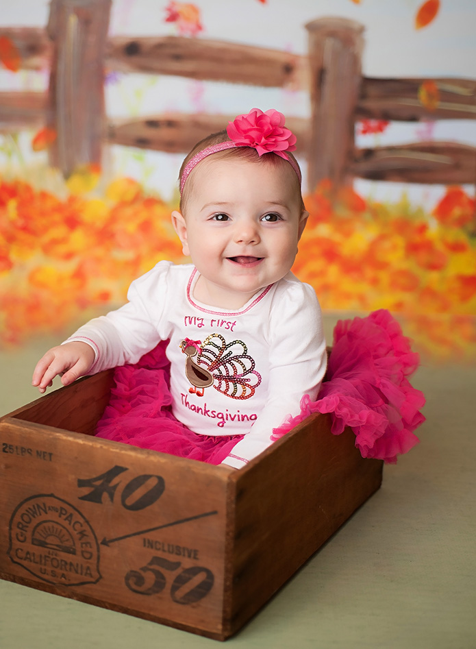 6 month old girl in pink tutu and bow