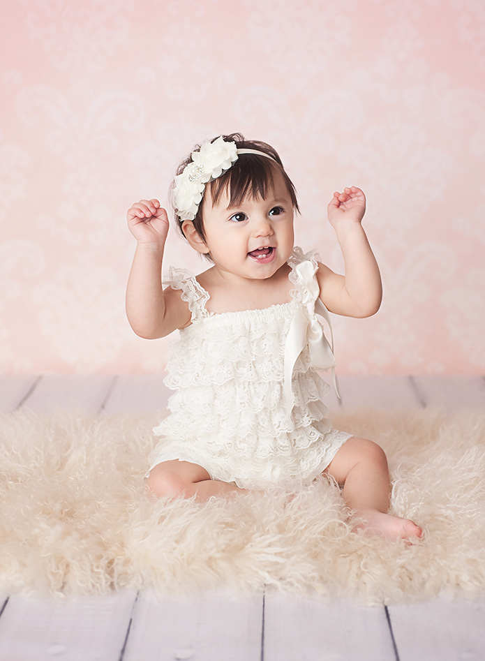 baby girl with a white romper on
