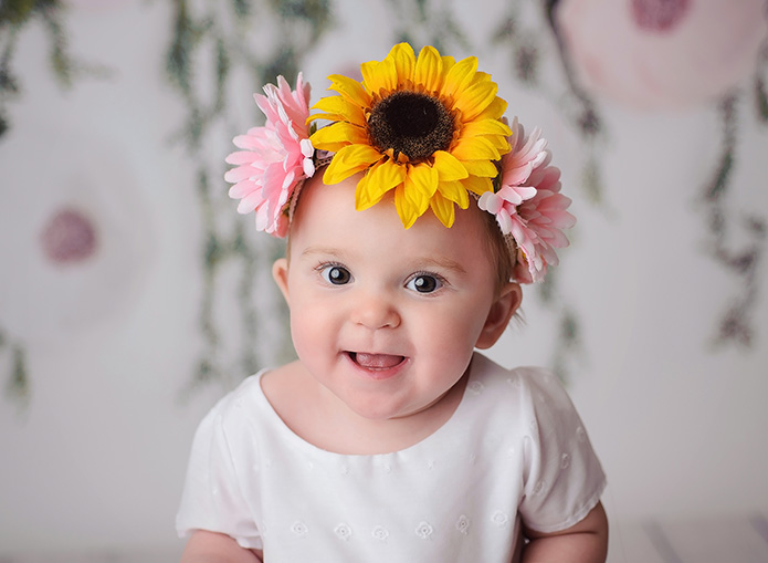 baby girl in floral crown