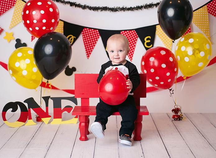 mickey mouse cake smash with boy and red balloon