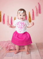 baby girl in pink valentines day outfit
