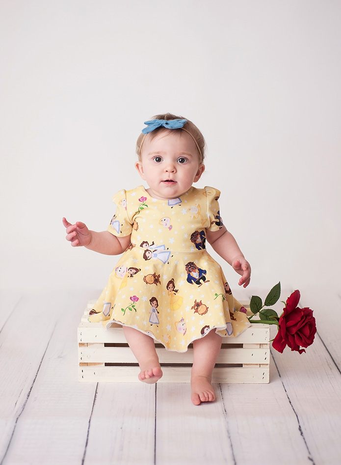 baby girl in beauty and the beast dress
